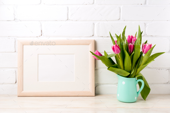 Wooden landscape frame mockup with pink tulips in jug - Stock Photo - Images
