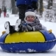Boy of Two Years Rolling on Tubing in the Park in Winter. - VideoHive Item for Sale