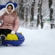 Young Girl Rolling on Tubing in the Park in Winter - VideoHive Item for Sale
