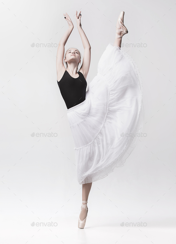 Young classical dancer isolated on white background. - Stock Photo - Images