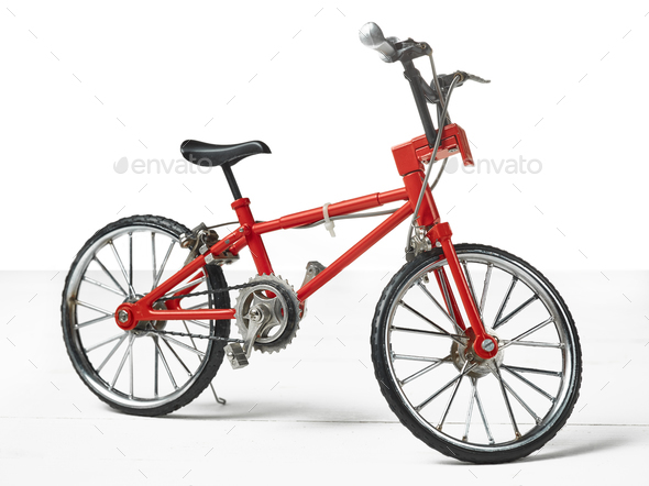 Vintage metal white bicycle toy over wooden table - Stock Photo - Images