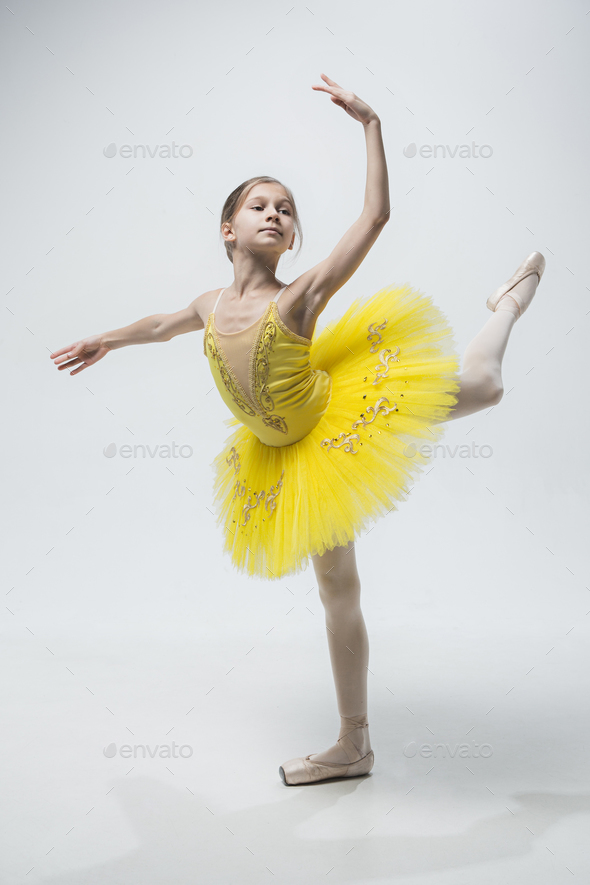 Young classical dancer on white background. - Stock Photo - Images
