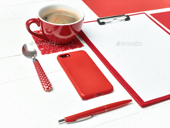Office table desk with set of colorful supplies, white blank note pad, cup, pen on white background. - Stock Photo - Images