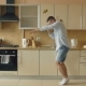 Handsome Young Funny Man Dancing in Kitchen at Home in the Morning and Have Fun on Holidays - VideoHive Item for Sale