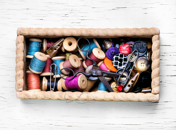 Thread spools and buttons - Stock Photo - Images