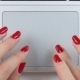 Woman's Hands with Red Manicure Using and Clicking a Portable Computer Trackpad - VideoHive Item for Sale