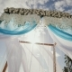 A Wedding Arch Decorated with Flowers and Large Wind-developing Fabrics on a Tropical Beach - VideoHive Item for Sale