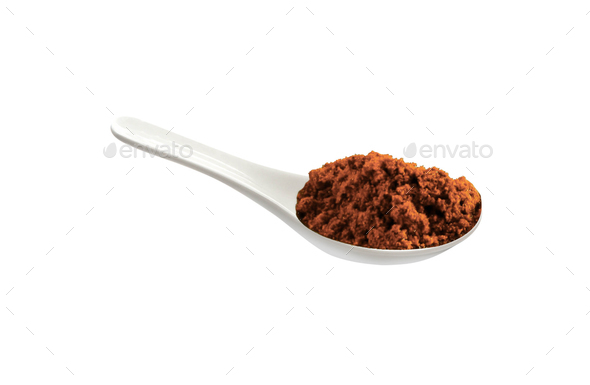 powder spice on a white porcelain spoon - Stock Photo - Images