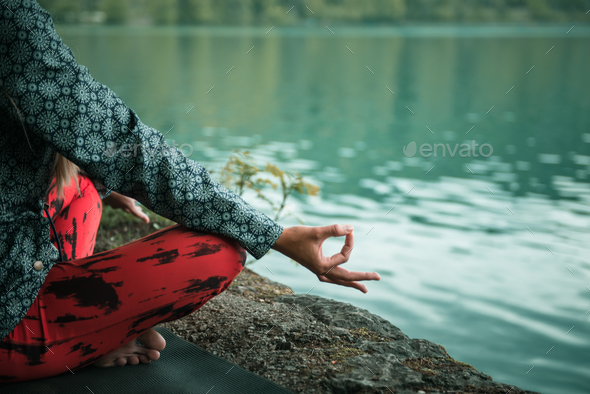 Meditating by the water - Stock Photo - Images