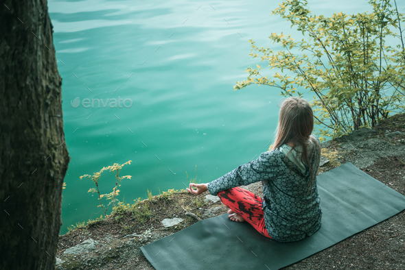 Meditation by the water - Stock Photo - Images