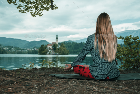 Mindful meditation by the lake - Stock Photo - Images