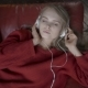 People Leisure Relax Concept. Young Woman in Headphones Listening Music and Relaxing at Home on Sofa - VideoHive Item for Sale