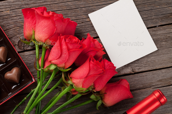 Valentines day with red roses and chocolate - Stock Photo - Images