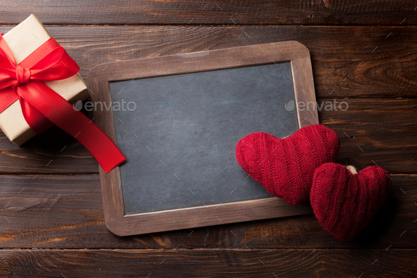 Valentines day greeting card with red hearts and gift - Stock Photo - Images