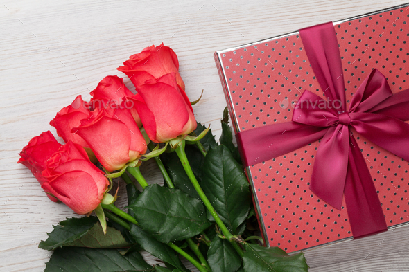Valentines day gift box and red roses - Stock Photo - Images