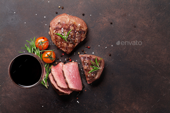 Grilled fillet steaks and glass of red wine - Stock Photo - Images