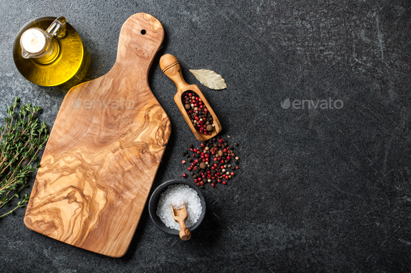 Cooking background with cutting board, utensils and ingredients - Stock Photo - Images