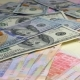 Old and New Money Dollar and Hryvnia Is Falling on the Table. - VideoHive Item for Sale