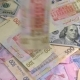 Old and New Money Dollar and Hryvnia Is Falling on the Table - VideoHive Item for Sale