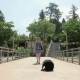 Girl Walking with the Funny Small Dog on the Pier. Batumi, Georgia - VideoHive Item for Sale