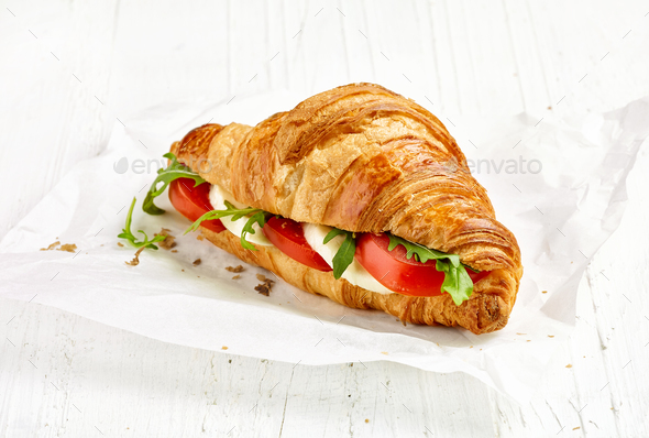 croissant sandwich with tomato and mozzarella - Stock Photo - Images