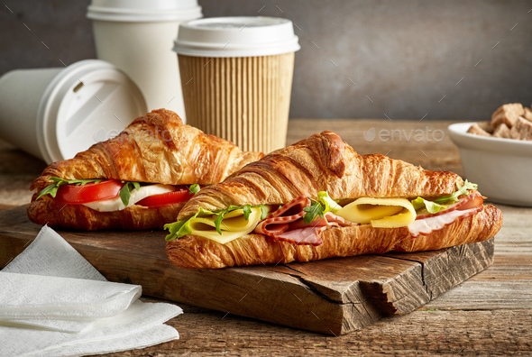 croissant sandwiches and coffee cups - Stock Photo - Images
