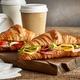 croissant sandwiches and coffee cups - PhotoDune Item for Sale