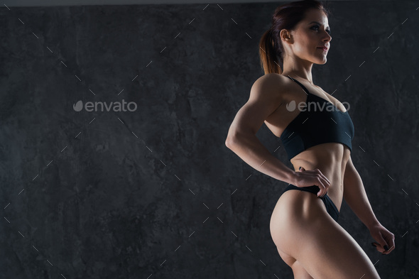 Close-up of a perfect female body over dark studio background - Stock Photo - Images