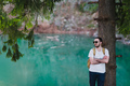 Bearded man model poses alongside a Green water Lake. - PhotoDune Item for Sale
