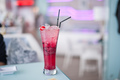 Glass of cherry soda with ice at cafe indoors - PhotoDune Item for Sale