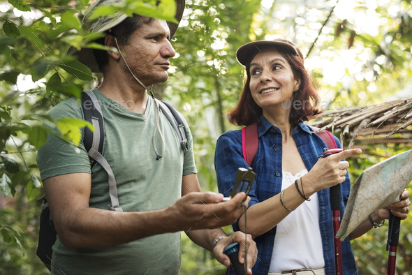 Couple trekking together - Stock Photo - Images