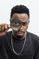 African man playing with a magnifying glass - PhotoDune Item for Sale