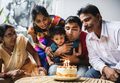 Indian family celebrating a birthday party - PhotoDune Item for Sale