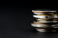 Closeup of coins stack isolated on black background - PhotoDune Item for Sale
