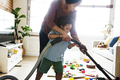 Son helping his mather clean the room - PhotoDune Item for Sale