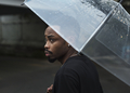 African descent man in an umbrella - PhotoDune Item for Sale