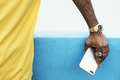 African man holding a smart phone - PhotoDune Item for Sale