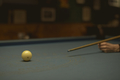 Woman playing pool at a bar - PhotoDune Item for Sale