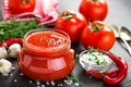 Tomato paste, puree in glass jar and fresh tomatos on dark background - PhotoDune Item for Sale