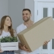 Happy Couple Watching Their New Home Excited. Young Woman Give Keys To Her Boyfriend and Kissing Him - VideoHive Item for Sale