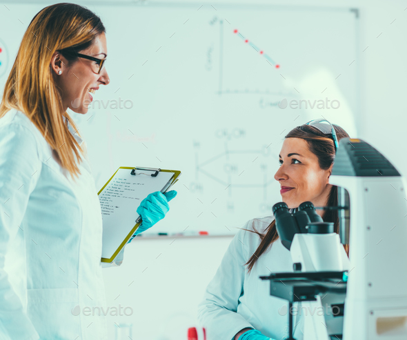 Scientists working in their lab - Stock Photo - Images