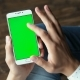 Young Man Using Phone with Mockup Green Screen - VideoHive Item for Sale
