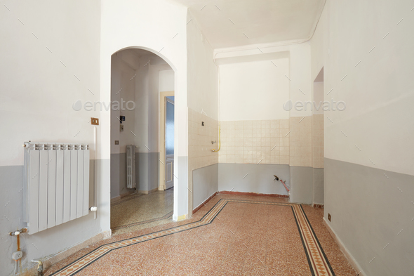 Empty living room and kitchen area interior in old