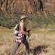 Active Woman with Trekking Sticks Hiking in Zion Park in the Background Rocks - VideoHive Item for Sale