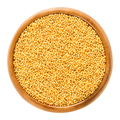 Gold nonpareils in wooden bowl on white background - PhotoDune Item for Sale