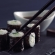 Using Chopsticks To Dip Sushi Into Soy Sauce, Japanese Food - VideoHive Item for Sale