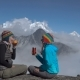 Two Girls Are Drinking Tea in the Mountains - VideoHive Item for Sale