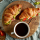 two croissant sandwiches on wooden table - PhotoDune Item for Sale