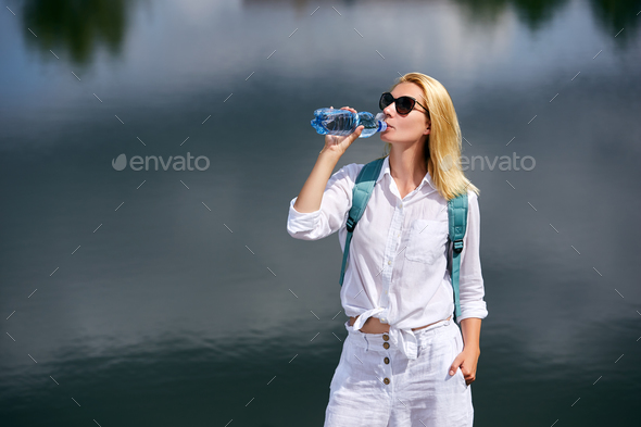 Young woman resting near lake - Stock Photo - Images