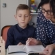 Teacher Explains to His Schoolboy the Homework that Was Done at the School - VideoHive Item for Sale